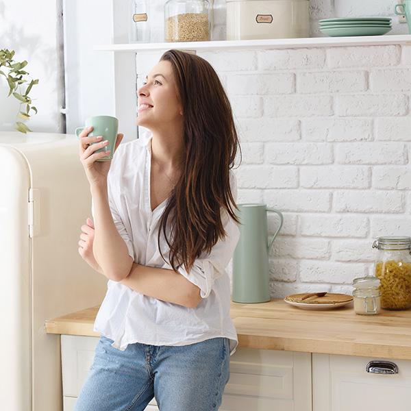 Woman Enjoying Her Organized Home